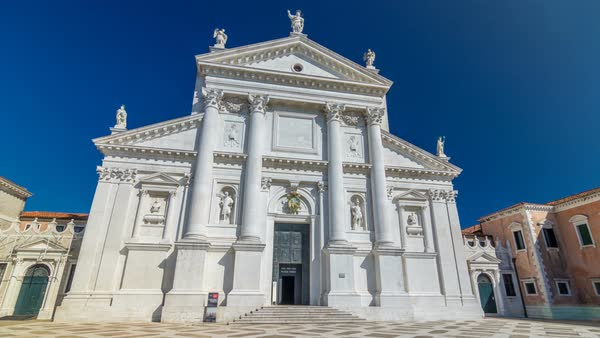Facade of Church of San Giorgio Maggiore on the island timelapse hyperlapse. One of the main attractions of Venice. Blue sky at summer day. Royalty-free stock video