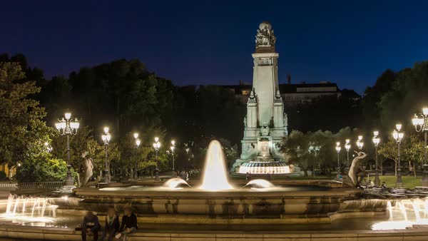 North-eastern side of the Cervantes monument timelapse on the Square of Spain (Plaza de Espana)  with fountain in Madrid in summer time in Spain. Madrid is popular tourist destination of Europe. night Royalty-free stock video
