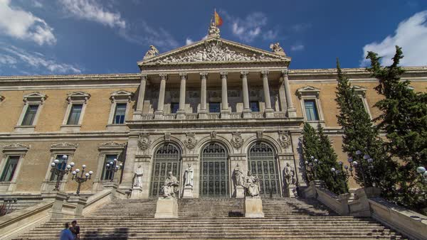 National Library of Spain (Biblioteca Nacional de Espana) timelapse hyperlapse is a major public library, largest in Spain and one of largest libraries in the world. It is located in Madrid, on the Paseo de Recoletos. Royalty-free stock video