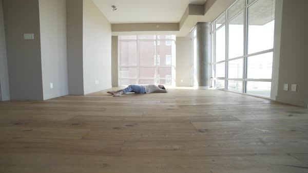 Wide shot of a dancer lying on the floor Royalty-free stock video