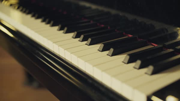 Close-up tracking shot of a classic piano indoors Royalty-free stock video