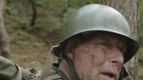 Tracking shot of a soldier fleeing in a forest Royalty-free stock video