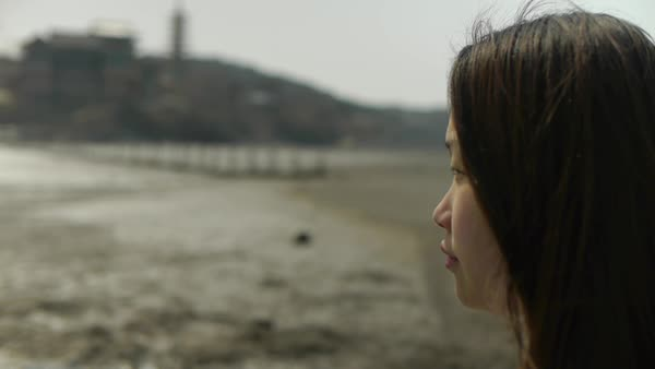 Hand-held close-up shot of young woman outdoors in Korea Royalty-free stock video