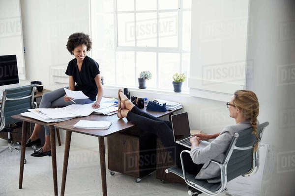 Two smiling businesswomen working together in an office Royalty-free stock photo