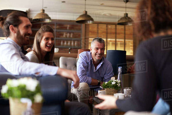 Group of friends meeting for coffee in bar Royalty-free stock photo