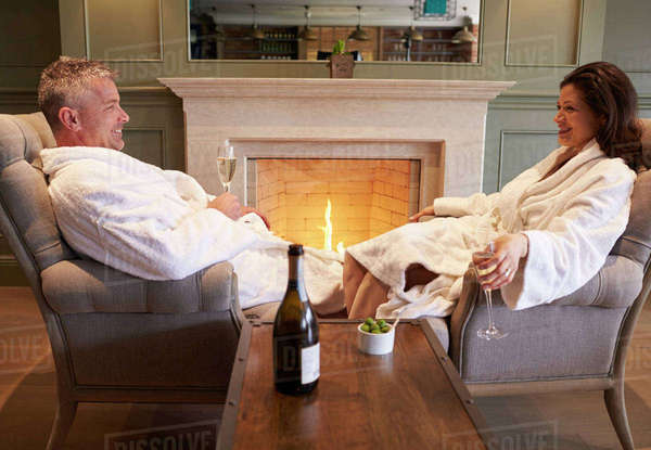 Couple wearing robes relaxing on hotel spa break Royalty-free stock photo