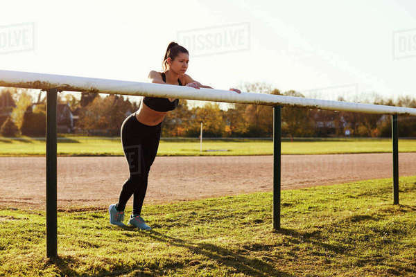 Young Woman Stretching During Outdoor Exercise Royalty-free stock photo