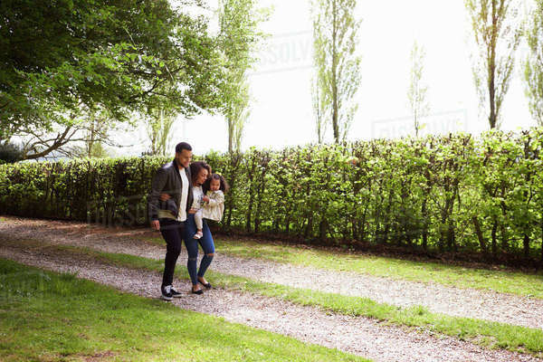 Mixed race couple with daughter walking in the countryside Royalty-free stock photo