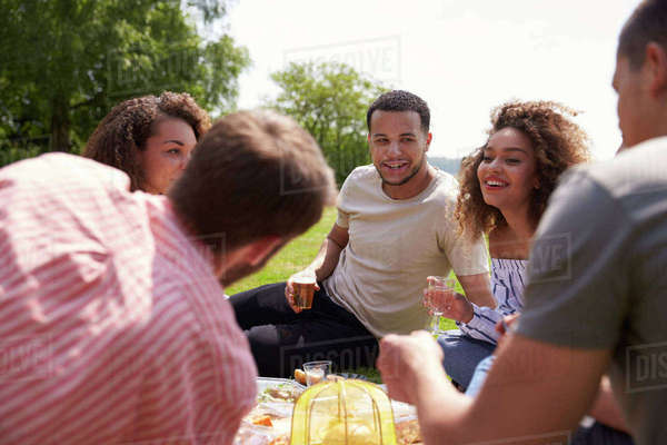 Group of friends having a picnic, close up, selective focus Royalty-free stock photo