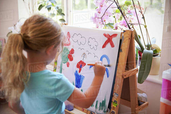 Girl Painting Picture On Easel At Home Royalty-free stock photo