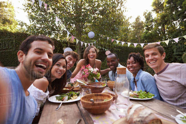 Friends Taking Selfie Around Table At Outdoor Party Royalty-free stock photo