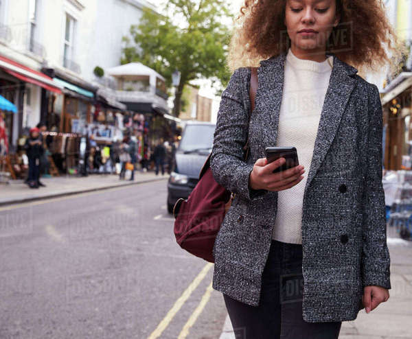 Close Up Of Woman Using Phone On Busy City Street Royalty-free stock photo