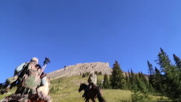 POV shot of people riding horses uphill Royalty-free stock video