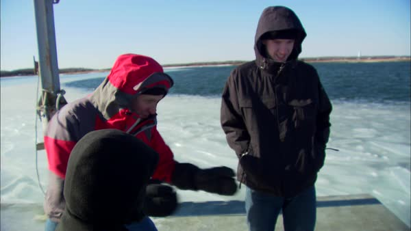 Montage of father and sons fishing in icy water Rights-managed stock video