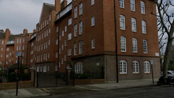 Low-angle shot of a red brick apartment building in London - Stock ...
