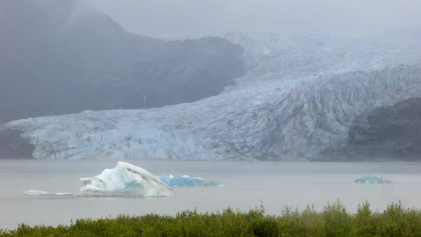 Locked-off shot of Mendenhall Glacier with a lake at frog in Alaska Rights-managed stock video