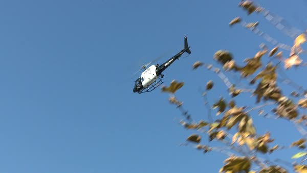 Tracking shot of a police helicopter flying above Rights-managed stock video