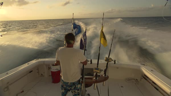 Hand-held shot view of a fishing boat and the fisherman Rights-managed stock video