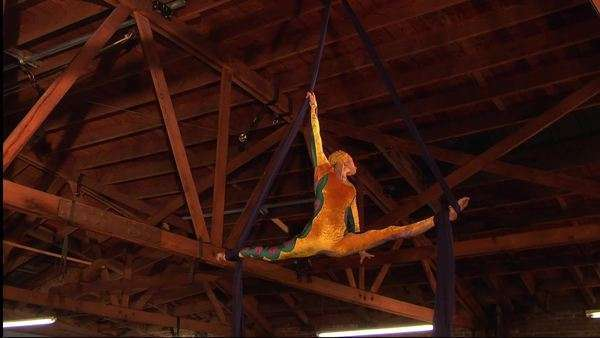 Low-angle shot of a woman performing aerial acrobatics Rights-managed stock video