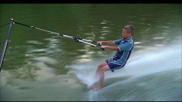 Montage of a boy doing water skiing tricks Rights-managed stock video