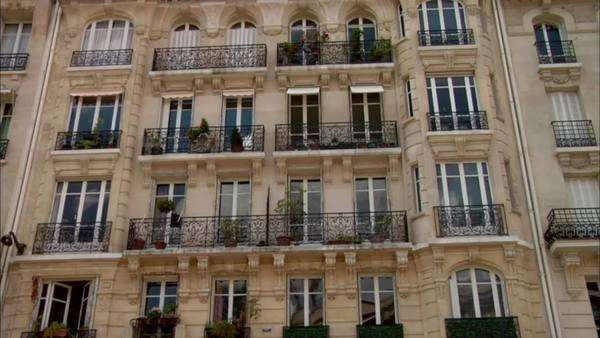 Tilt-up shot of an apartment building in Paris Rights-managed stock video