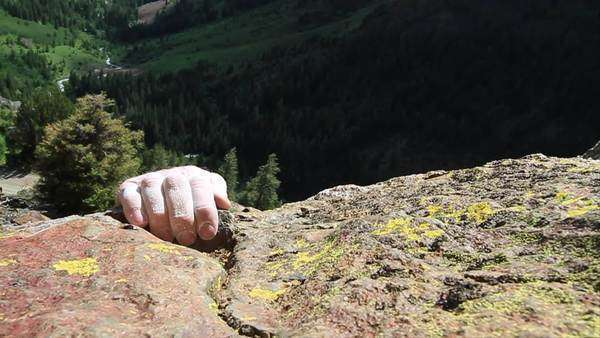 Slow motion of a climber topping out in Sun Valley, Idaho Rights-managed stock video
