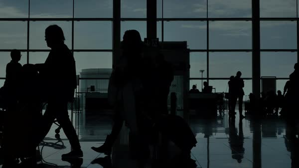 Airport terminal hall silhouette walking travelers close up Royalty-free stock video