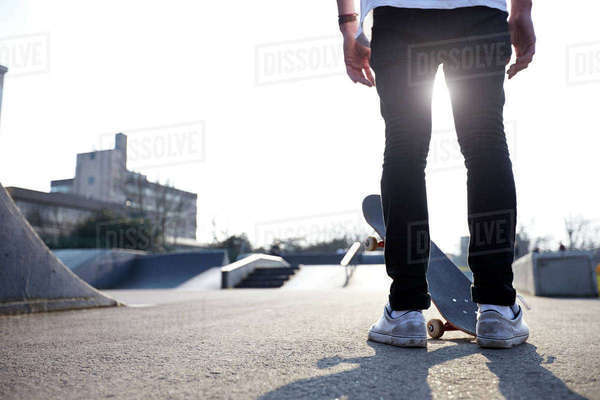 Close-up of skateboarders feet on skateboard Royalty-free stock photo