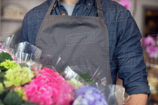 Close up portrait of male florist at work in shop Royalty-free stock photo