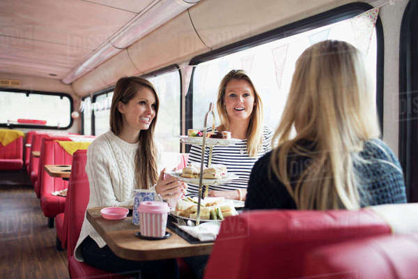 Group of young female friends meeting in tea bus Royalty-free stock photo