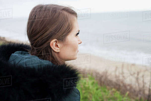 Rear view of young woman looking out to sea Royalty-free stock photo