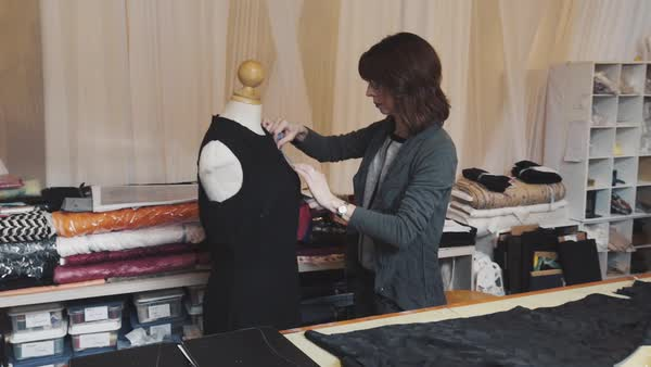 Hand-held shot of a designer making a dress Royalty-free stock video