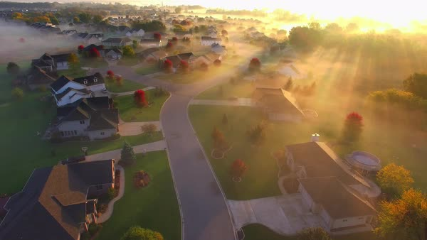 Tranquil idyllic wealthy Autumn neighborhood shrouded in fog at dawn, Fall colors. Royalty-free stock video