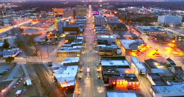 Stunning twilight aerial view Downtown Appleton Wisconsin, College Avenue, city lights. Royalty-free stock video