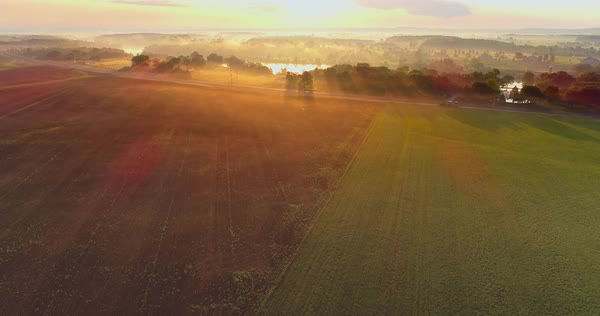 In the moment; sunrise over foggy landscape and river, aerial view. Royalty-free stock video