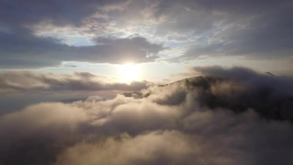 Flying above the clouds in the evening Royalty-free stock video