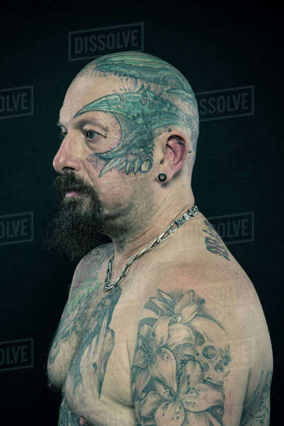 Studio portrait of a heavily tattooed older man Royalty-free stock photo