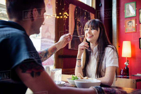 A young couple enjoying a meal together in a coffee shop in Manchester Royalty-free stock photo