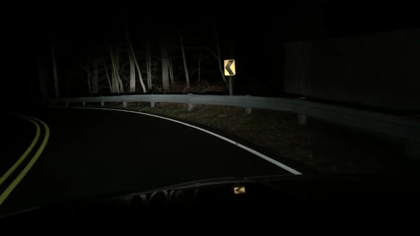 Hand-held shot of driving on an unlit road at night Royalty-free stock video