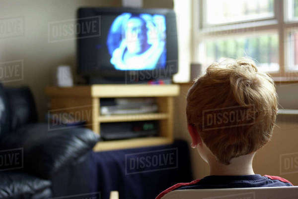 A boy watching TV in his house. Rights-managed stock photo