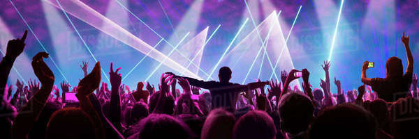 Fans At Concert Enjoy Music And Take Photos On Cellphones Royalty-free stock photo