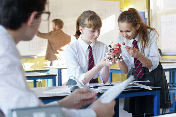 High school students assembling molecule model in science class Royalty-free stock photo