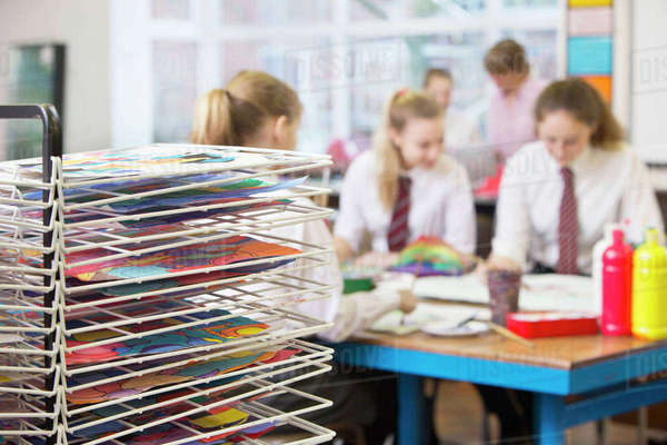 Middle school students painting in art class Royalty-free stock photo