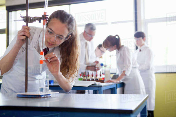 High school student conducting scientific experiment in chemistry class Royalty-free stock photo