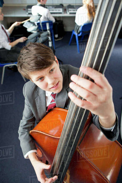 Middle school student playing double bass in music class Royalty-free stock photo