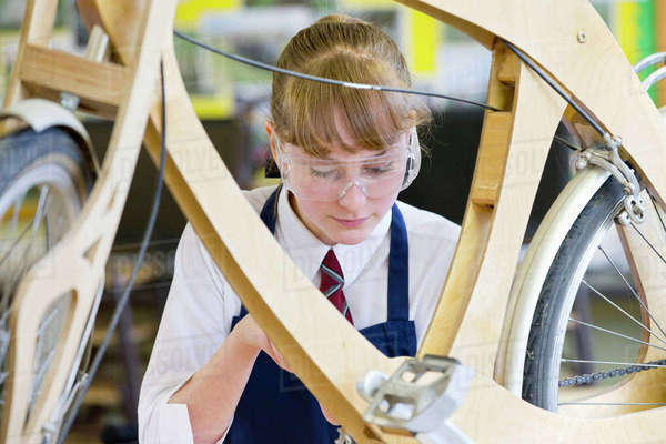 High school student assembling bicycle in shop class Royalty-free stock photo