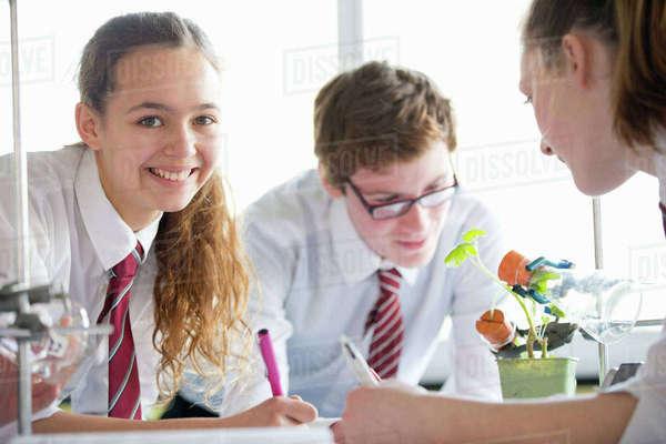 Portrait high school students conducting scientific experiment in biology class Royalty-free stock photo