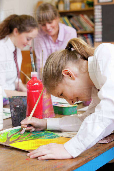 Middle school student painting in art class Royalty-free stock photo