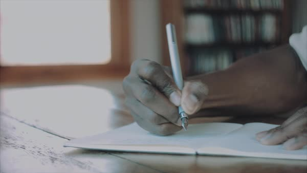 Close-up shot of a person taking notes Royalty-free stock video