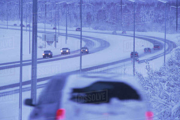 Cars Driving In Snowstorm Glenn Hwy Southcentral Alaska Winter Rights-managed stock photo